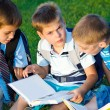 Elementary students reading — Stock Photo #5775037