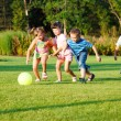 Kids with ball - Stockfoto