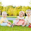 Stock Photo: Toddlers on grass