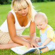 Mother and son in backyard — Stock Photo #5775168