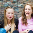 Teenage girls laughing — Stock Photo