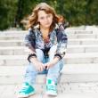 Girl sitting on stairs — Stock Photo #5775188