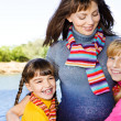 Woman embracing her daughters — Stock Photo