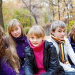 Cheerful teens in fall — Stock Photo #5775340