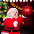 Baby playing with Christmas ball — Stock Photo #5775355