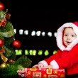 Baby in Santa costume over black — Stock Photo