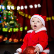 Surprised toddler with Christmas ball - Stock Photo