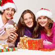 Teenagers packing Christmas gifts — Stock Photo