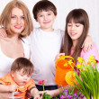 Stock Photo: Family watering flowers