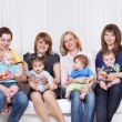 Stock Photo: Four mothers with toddlers