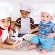Kids playing with flour - Stock Photo