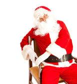 Santa in chair — Stock Photo