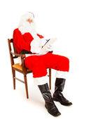Santa Claus with wish list — Stock Photo