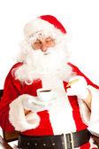 Santa claus con café y galletas — Foto de Stock
