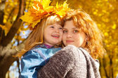 Mother and daughter in autumn — Stock Photo