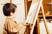Kid painting — Stockfoto