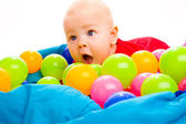 Baby with colorful balls — Stock Photo