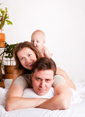 Lovely family in bed — Stock Photo