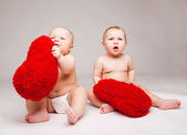 Valentine babies with fluffy hearts — Stock Photo