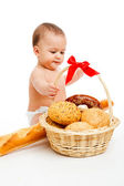 Baby and bread — Stock Photo