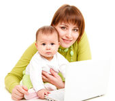 Mom and baby working at netbook — Stock Photo