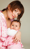 Mom holding baby girl in hands — Stock Photo