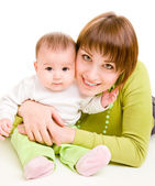 Mother embracing infant — Stock Photo