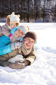 Family in winter park — Stock Photo