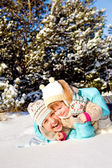 Mother with kid in snow — Stock Photo