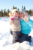 Woman and girl in snow — Stock Photo