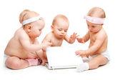 Babies working at laptop — Stock Photo
