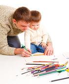 老爸和儿子一起绘图 — 图库照片
