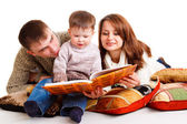 Mom and dad reading for the kid — Stock Photo
