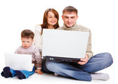 Parents and toddler with laptops — Stock Photo