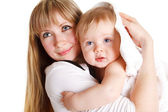 Mother and baby in towel — Stock Photo