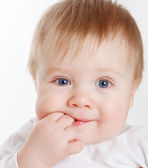 Baby with fingers in mouth — Stock Photo