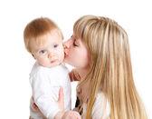 Female kissing baby — Stock Photo