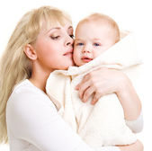 Mom embracing baby — Stock Photo