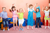 Preschoolers jumping — Stock Photo