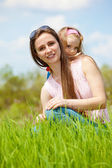Mother and curly daughter — Stock Photo