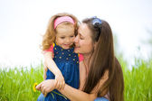 Mother and curly girl — Stock Photo