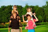 Padres con niños — Foto de Stock