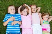 Kids on grass — Zdjęcie stockowe
