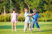 Preschool boy throwing frisbie — Stock Photo