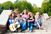 Teens playing guitar — Stok fotoğraf
