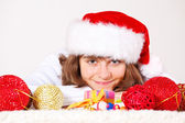 Teenage girl among Christmas balls — Stock Photo
