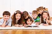 Kids crowd reading book — Stock Photo