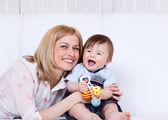 Female and toddler laughing — Stock Photo