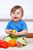Baby with fruit — Stock Photo