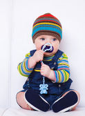 Baby with soother — Stock Photo